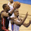 Miami\'s Chris Bosh (1) goes past Oklahoma City\'s Serge Ibaka (9) during Game 2 of the NBA Finals between the Oklahoma City Thunder and the Miami Heat at Chesapeake Energy Arena in Oklahoma City, Thursday, June 14, 2012. Photo by Nate Billings, The Oklahoman
