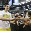 Michigan\'s Mitch McGary celebrates after a regional final game against Florida in the NCAA college basketball tournament, Sunday, March 31, 2013, in Arlington, Texas. Michigan won 79-59 to advance to the Final Four. (AP Photo/David J. Phillip)