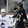 Photo - Anaheim Ducks' Teemu Selanne, right, of Finland, celebrates his goal as Vancouver Canucks' Chris Tanev looks on during the first period of an NHL hockey game on Wednesday, Jan. 15, 2014, in Anaheim, Calif. (AP Photo/Jae C. Hong)
