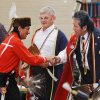 Steve Kaudlekaule shakes hands of fellow dancers during one of the gourd dances. He is a member of the Comanche Nation and drove from Ponca City to attend the pow-wow. At least 500 people representing several dozen Native American Nations within the state attended a New Year\'s pow-wow in the Centennial Building at State Fair Park Saturday , January 7, 2012, The celebration started around shortly after noon and continued into the night. Several hundred took part in the various dancers and the dancers wore tribal regalia. Photo by Jim Beckel, The Oklahoman