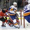 New York Islanders center Josh Bailey (12) scores a goal past New Jersey Devils\' goalie Martin Brodeur (30) and Marek Zidlicky, of Czech Republic (2) during the first period of an NHL hockey game Monday, April 1, 2013, in Newark, N.J. (AP Photo/Mel Evans)