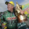 Photo - In this photo provided by the NHRA, Funny Car icon John Force celebrates after his victory Sunday, July 6, 2014, at the Summit Racing Equipment NHRA Nationals at Norwalk, Ohio. Force outran longtime rival Ron Capps to earn his 140th career victory and second win of the NHRA Mello Yello Drag Racing Series season. It was his first win at Summit Motorsports Park. (AP Photo/NHRA, Marc Gewertz)