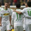 Photo - Moenchengladbach's Max Kruse, second from left, celebrates with teammates after scoring  during the German first division Bundesliga soccer match between BvB Borussia Dortmund  and VfL Borussia Moenchengladbach in Dortmund, Germany, Saturday, March 15, 2014. (AP Photo/Frank Augstein)