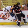 Photo - Ottawa Senators center Zack Smith collides with New York Islanders center John Tavares, left, along the boards during the first period of an NHL hockey game in Ottawa, Ontario, Tuesday, Feb. 19, 2013. (AP Photo/The Canadian Press, Adrian Wyld)