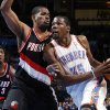 Oklahoma City\'s Kevin Durant (35) drives to the basket as Kurt Thomas (40) defends for Portland in the first half during the NBA basketball game between the Oklahoma City Thunder and Portland Trail Blazers at Chesapeake Energy Arena in Oklahoma City, Tuesday, Jan. 3, 2012. At left is Gerald Wallace (3) of the Trail Blazers. Photo by Nate Billings, The Oklahoman