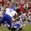 OU\'s Justin Brown (19) stretches for more yards past KU\'s Greg Brown (5) during the college football game between the University of Oklahoma Sooners (OU) and the University of Kansas Jayhawks (KU) at Gaylord Family-Oklahoma Memorial Stadium on Saturday, Oct. 20th, 2012, in Norman, Okla. Photo by Chris Landsberger, The Oklahoman