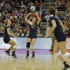 Michigan\'s Ally Sabol (13) sets for teammates Lexi Dannemiller, left, and Lexi Erwin,, right, against Texas during the national semifinals of the NCAA college women\'s volleyball tournament semifinal in Louisville, Ky., Thursday, Dec. 13, 2012. (AP Photo/Garry Jones)