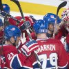 Photo - Players from the Montreal Canadiens celebrate after defeating the Tampa Bay Lightning following Stanley Cup hockey playoff game in Montreal, Sunday, April 20, 2014. (AP Photo/The Canadian Press, Graham Hughes)