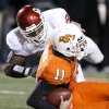 OU\'s Keenan Clayton sacks Zac Robinson of OSU during the college football game between the University of Oklahoma Sooners (OU) and Oklahoma State University Cowboys (OSU) at Boone Pickens Stadium on Saturday, Nov. 29, 2008, in Stillwater, Okla. STAFF PHOTO BY BRYAN TERRY
