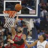Chicago Bulls forward Carlos Boozer (5) goes to the basket as New Orleans Pelicans forward Anthony Davis (23) and guard Eric Gordon (10) watch during the first half of an NBA basketball game in New Orleans, Saturday, Feb. 1, 2014. (AP Photo/Bill Haber)