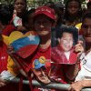 A woman holds a picture of Venezuela\'s President Hugo Chavez as supporters gather at Simon Bolivar square in Caracas,Venezuela, Sunday Dec. 9, 2012. Chavez is to return to Cuba Sunday for another surgery in his battle against cancer, which has led him to speak publicly of a successor for the first time. Chavez said Saturday that if there are