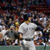 Photo - New York Yankees' Jacoby Ellsbury is booed by fans as he walks to the plate for his first at-bat during the first inning of a baseball game at Fenway Park in Boston, Tuesday, April 22, 2014. (AP Photo/Elise Amendola)