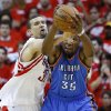 Oklahoma City\'s Kevin Durant (35) goes for the ball beside Houston\'s Houston\'s Francisco Garcia (32) during Game 6 in the first round of the NBA playoffs between the Oklahoma City Thunder and the Houston Rockets at the Toyota Center in Houston, Texas, Friday, May 3, 2013. Oklahoma City won 103-94. Photo by Bryan Terry, The Oklahoman