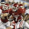 Oklahoma\'s Demarco Murray (7) runs during the Fiesta Bowl college football game between the University of Oklahoma Sooners and the University of Connecticut Huskies in Glendale, Ariz., at the University of Phoenix Stadium on Saturday, Jan. 1, 2011. Photo by Bryan Terry, The Oklahoman