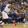 Photo - New York Knicks' Amar'e Stoudemire, left,, reaches for the ball after Philadelphia 76ers' Thaddeus Young, right, knocked it away from him during the first half of an NBA basketball game, Saturday, Jan. 11, 2014, in Philadelphia.  (AP Photo/Chris Szagola)