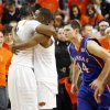 OSU fans take the court as Matt Pilgrim (31), left, and Obi Muonelo (2) hug, while KU\'s Tyrel Reed (14) and Xavier Henry (1) leave the court at the end of the men\'s college basketball game between the University of Kansas (KU) and Oklahoma State University (OSU) at Gallagher-Iba Arena in Stillwater, Okla., Saturday, Feb. 27, 2010. OSU won, 85-77. Photo by Nate Billings, The Oklahoman