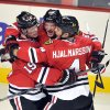 Photo - Chicago Blackhawks' Brandon Saad, center, celebrates with teammates Jonathan Toews (19) and Niklas Hjalmarsson (4) after Saad's goal against the Nashville Predators during the first period of an NHL hockey game Monday, April 1, 2013, in Chicago. (AP Photo/Jim Prisching)
