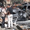 In this photo released by the Syrian official news agency SANA, Syrian citizens gather near damaged cars that were burned after a car bomb exploded in the suburb of Jaramana, Damascus, Syria, Thursday , July 25, 2013. Syria\'s state-run news agency says many people have been killed and scores wounded in a powerful car bomb explosion near Damascus. (AP Photo/SANA)
