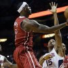 Photo - Miami Heat's LeBron James (6) shoots over Atlanta Hawks' Al Horford (15) in the first half of an NBA basketball game, Monday, Dec. 23, 2013, in Miami. (AP Photo/Lynne Sladky)