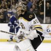 Boston Bruins goalie Tuukka Rask shouts out after stopping Toronto Maple Leafs\' Nikolai Kulemin, rear, on the final shot of the shootout during Boston\'s 3-2 win in an NHL hockey game in Boston Monday, March 25, 2013. (AP Photo/Winslow Townson)