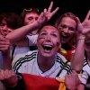 Photo - German soccer fans celebrate after their team won the Brazil World Cup semi final being played in Belo Horizonte, Brazil, between Germany and Brazil at a public viewing event called 'Fan Mile' in Berlin, Tuesday, July 8, 2014. (AP Photo/Markus Schreiber)