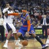 Photo - New York Knicks forward Carmelo Anthony, right, drives to the basket against Sacramento Kings defender Derrick Williams during the first half of an NBA basketball game in Sacramento, Calif., Wednesday, March 26, 2014. (AP Photo/Steve Yeater)