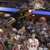 Photo - Baylor forward Rico Gathers (2) dunks against Wisconsin during the second half of an NCAA men's college basketball tournament regional semifinal, Thursday, March 27, 2014, in Anaheim, Calif. (AP Photo/Jae C. Hong)