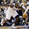 Photo - Philadelphia 76ers' Jason Richardson, left, and Minnesota Timberwolves' Luke Ridnour chase a loose ball in the first half of an NBA basketball game, Tuesday, Dec. 4, 2012, in Philadelphia. (AP Photo/Matt Slocum)
