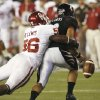 Ronnell Lewsi (56) strips the ball from quarterback Zach Collaros (12) late in the fourth quarter of the college football game between the University of Oklahoma Sooners (OU) and the University of Cincinnati Bearcats (UC) at Paul Brown Stadium on Saturday, Sept. 25, 2010, in Cincinnati, Ohio. Photo by Steve Sisney, The Oklahoman