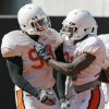 Photo - COLLEGE FOOTBALL: Richetti Jones (99), left, and Lucien Antoine (31) celebrate a safety during an OSU spring football scrimmage at Boone Pickens Stadium at Oklahoma State University in Stillwater, Okla., Friday, April 4, 2008. BY NATE BILLINGS, THE OKLAHOMAN ORG XMIT: KOD