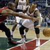 Milwaukee Bucks\' Monta Ellis, right, and Miami Heat\'s Dwyane Wade battle for a loose ball during the first half of Game 3 in their first-round NBA basketball playoff series on Thursday, April 25, 2013, in Milwaukee. (AP Photo/Morry Gash)
