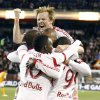 Photo - New York Red Bulls midfielder Dax McCarty, top, jumps on teammates while celebrating a goal by Bradley Wright-Phillips (99) against the Houston Dynamo during the first half of an MLS soccer game on Wednesday, April 23, 2014, in Harrison, N.J. (AP Photo/Julio Cortez)