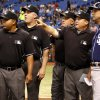 Umpires, from left, Adrian Johnson, Bill Welke, Brian O\'Nora and Fieldin Culbreth meet with San Diego Padres third base coach Glenn Hoffman before an interleague baseball game against the Tampa Bay Rays, Friday, May 10, 2013, in St. Petersburg, Fla. (AP Photo/Mike Carlson)