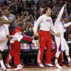 Los Angeles Clippers bench celebrates a basket against the Oklahoma City Thunder during the first half of an NBA basketball game in Los Angeles, Monday, Jan. 30, 2012. (AP Photo/Chris Carlson)