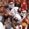 Oklahoma\'s Landry Jones (12) drops back to pass during a college football game between the University of Oklahoma (OU) and Iowa State University (ISU) at Jack Trice Stadium in Ames, Iowa, Saturday, Nov. 3, 2012. Oklahoma won 35-20. Photo by Bryan Terry, The Oklahoman