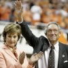 Former OSU head coach Eddie Sutton waves to the crowd as wife Patsy Sutton applauds a ceremony at halftime during the men\'s college basketball game between Oklahoma State University and Texas A&M at Gallagher-Iba Arena in Stillwater, Okla., Wednesday, Feb. 21, 2007. By Matt Strasen, The Oklahoman