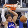 Photo -   Los Angeles Clippers forward Blake Griffin dunks during the first half of their NBA basketball game against the San Antonio Spurs, Wednesday, Nov. 7, 2012, in Los Angeles. (AP Photo/Mark J. Terrill)