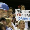Photo - Texas Rangers' Yu Darvish fans hold up a picture of his likeness with a sign that reads