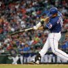 Texas Rangers\' Mitch Moreland (18) flies out against the Mexico City Red Devils during the second inning of a spring training exhibition baseball game, Thursday, March 28, 2013, in Arlington, Texas. (AP Photo/The Fort Worth Star-Telegram, Brandon Wade) MAGS OUT; (FORT WORTH WEEKLY, 360 WEST); INTERNET OUT