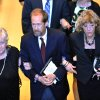 Elmore Leonard\'s son Chris Leonard, center, walks arm-in-arm with his mother Beverly Decker (Elmore\'s first wife) and his wife Suzy Leonard at the conclusion of his father\'s funeral mass inside Holy Name Church in Birmingham, Mich, Saturday Aug. 24, 2013/ The beloved Metro-Detroit crime novelist Elmore Leonard died Tuesday at his home in Bloomfield Village at age 87. (AP Photo/The Detroit News, John T. Greilick)