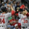 Washington Nationals\' Bryce Harper (34) and Ian Desmond (20) celebrate after scoring on Desmond\'s home run in the fourth inning of a baseball game against the Atlanta Braves on Wednesday, May 1, 2013, in Atlanta. (AP Photo/John Bazemore)