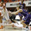 Oklahoma State\'s Kendra Suttles (31) and Liz Donohoe (4) go for a loose ball beside TCU\'s Kamy Cole (11) during a women\'s college basketball game between Oklahoma State University and TCU at Gallagher-Iba Arena in Stillwater, Okla., Tuesday, Feb. 5, 2013. Oklahoma State won 76-59. Photo by Bryan Terry, The Oklahoman
