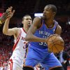 Oklahoma City\'s Kevin Durant (35) looks to pass beside Houston\'s Francisco Garcia (32) during Game 4 in the first round of the NBA playoffs between the Oklahoma City Thunder and the Houston Rockets at the Toyota Center in Houston, Texas,Sunday, April 29, 2013. Photo by Bryan Terry, The Oklahoman