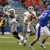 Oklahoma State\'s J.W. Walsh (4) looks to throw a pass during the college football game between Oklahoma State University (OSU) and the University of Kansas (KU) at Memorial Stadium in Lawrence, Kan., Saturday, Oct. 13, 2012. Photo by Sarah Phipps, The Oklahoman