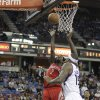 Photo - Houston Rockets guard Patrick Beverly, left, shoots against Sacramento Kings center DeMarcus Cousins during the first quarter of an NBA basketball game in Sacramento, Calif., Tuesday Feb. 25, 2014. (AP Photo/Rich Pedroncelli)