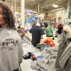 Photo - Tonya Knoles, of Edmond, checks a Thunder T-shirt for size at Academy Sports + Outdoors in Edmond. The retailer reopened its stores following Wednesday night's win to sell NBA Finals gear.