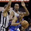 Oklahoma Thunder\'s Russell Westbrook (0) is pressured by San Antonio Spurs\' Tony Parker, left, of France, and Boris Diaw, center, of France, during the first quarter of an NBA basketball game, Thursday, Nov. 1, 2012, in San Antonio. (AP Photo/Eric Gay) ORG XMIT: TXEG109