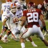 Florida\'s Tim Tebow (15) looks for running room past Oklahoma\'s Travis Lewis (28) during the second half of the BCS National Championship college football game between the University of Oklahoma Sooners (OU) and the University of Florida Gators (UF) on Thursday, Jan. 8, 2009, at Dolphin Stadium in Miami Gardens, Fla. Oklahoma lost the game 24-14 to the Gators. PHOTO BY CHRIS LANDSBERGER, THE OKLAHOMAN