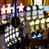 In this Sept. 18, 2013, photo, a security camera hangs above slot machines at Mohegan Sun in Uncasville, Conn. As table games spread across the Northeast, resorts are using their own intelligence network more than ever to stay ahead of suspect players _ professional thieves as well as card counters _ who can easily hit multiple casinos in the span of a few days. (AP Photo/Jessica Hill)