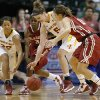 Iowa State\'s Hallie Christofferson (5) and Brynn Williamson (22) go for the ball between Oklahoma\'s Aaryn Ellenberg (3) and Morgan Hook (10) during the Big 12 tournament women\'s college basketball game between the University of Oklahoma and Iowa State University at American Airlines Arena in Dallas, Sunday, March 10, 2012. Photo by Bryan Terry, The Oklahoman